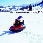 Snowtubing in Tiroler Kaiserwinkl is fun